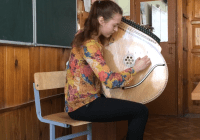 Watch this video of a girl playing the Bandura and discover the history behind it