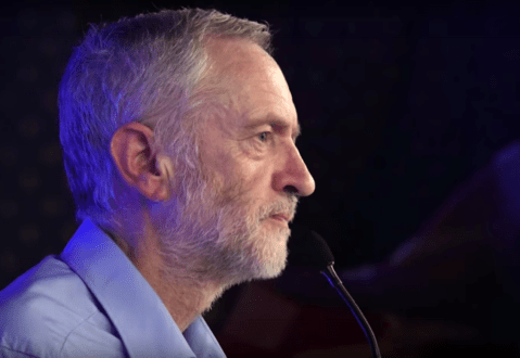 Jeremy Corbyn speaking at a political rally at Liverpool Adelphi Hotel banquet room on 1st August (2015). Author: YouTube/exadverso Link: https://commons.wikimedia.org/wiki/File:Corbyn_Liverpool_2.png