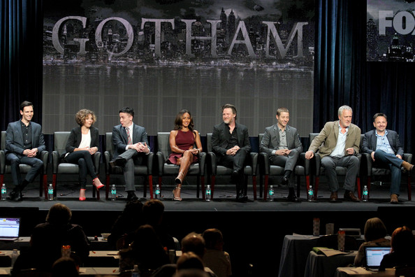 """(L-R) Actors Cory Michael Smith, Camren Bicondova, Robin Lord Taylor, Jada Pinkett Smith, Donal Logue, and Benjamin McKenzie, and producers Bruno Heller and Danny Cannon speak onstage at the """"Gotham"""" panel during the FOX Network portion of the 2014 Summer Television Critics Association at The Beverly Hilton Hotel on July 20, 2014 in Beverly Hills, California"""