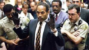 O.J. Simpson holds up his hands to the jury wearing the infamous gloves found at the crime scene and his home in this June 15, 1995 file ... <a rel=