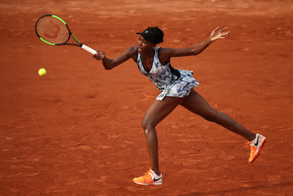 Venus Williams of The United States plays a forehand during the ladies singles first round match against Qiang Wang of China on day one of the 2017 French Open at Roland Garros on May 28, 2017 in Paris, France.