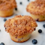 Bakery style buttermilk blueberry muffins with crumb topping