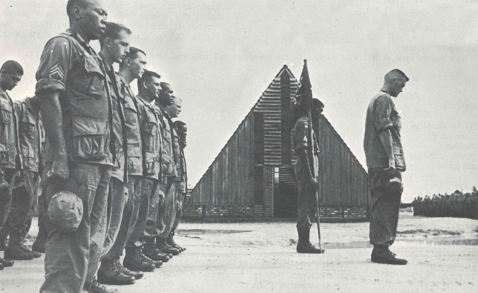 Solemn moments. The Second Battalion pauses in honor of fallen comrades after Bien Hoa. Chaplain (Capt.) Robert Crick is the chaplain to this airborne brigade.