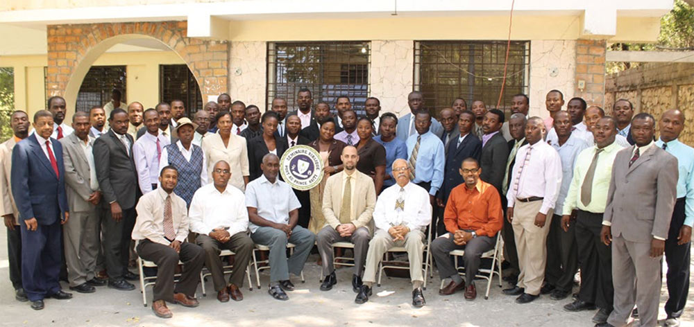 Josh Rice with students and faculty at the Church of God seminary in Haiti