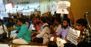 Protesters protesting at the Book launch function