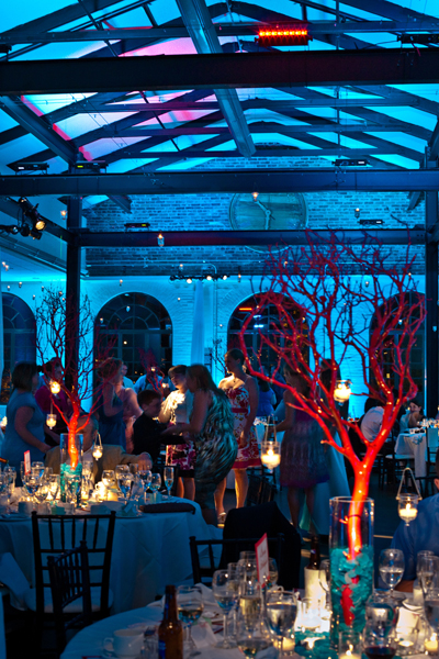 Underwater effect with rich blue lighting and pinspotted red coral branch centerpieces