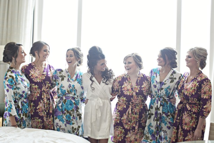 bridesmaids getting ready in floral robes four seasons hotel