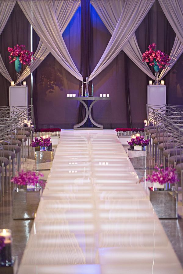 white acrylic light up aisle with silver fabric backdrop purple chiffon pink orchids