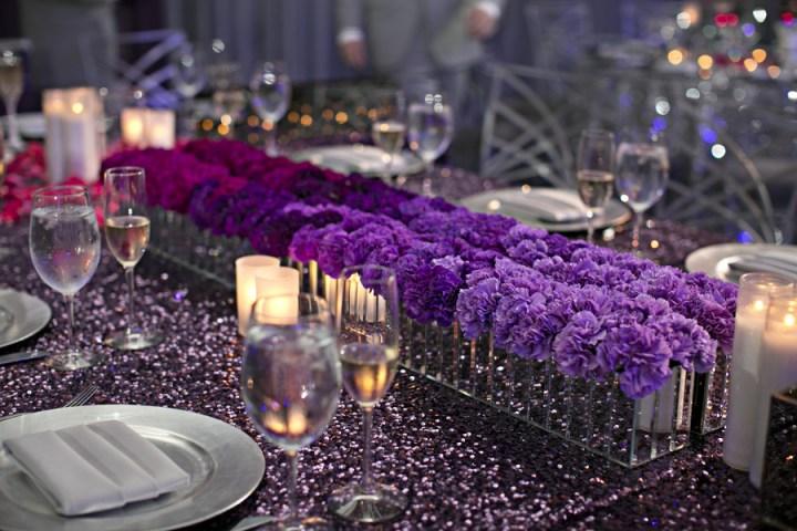 purple pink ombre flower arrangement on purple sequin tablecloth linen