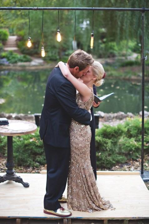 Bride and groom kiss custom lightbulb altar