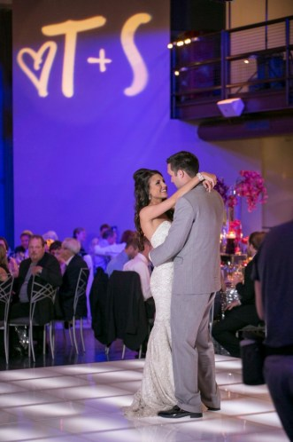 Bride and groom first dance acrylic glow dance floor with wedding monogram gobo