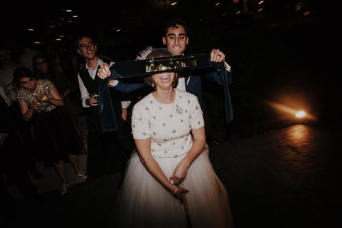 Bride takes a shot at the pinata | Events Luxe Weddings