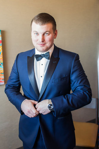Groom getting ready red winter wedding   Events Luxe Wedding