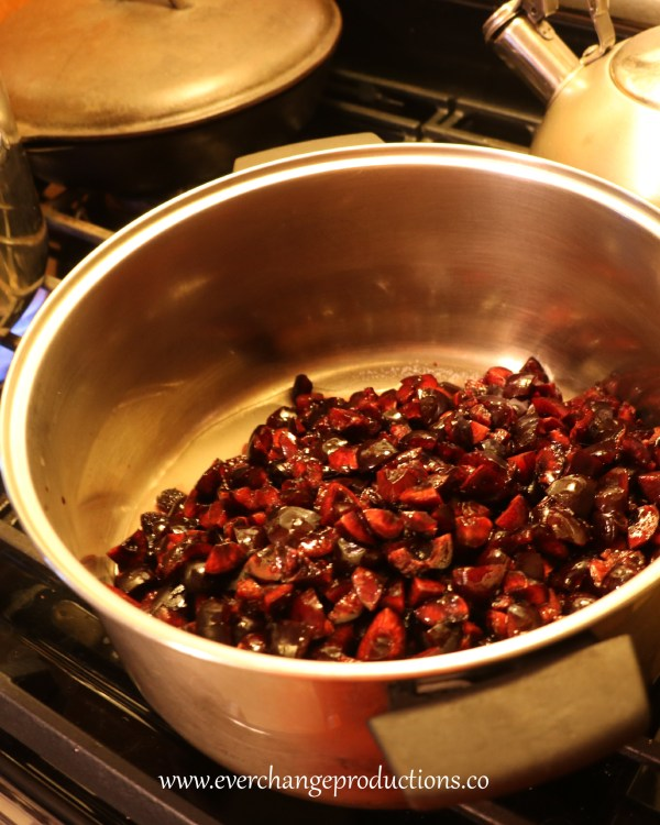 In 6-8 quart sauce pan mix in the sugar, pectin, lemon and almond extract. Then add the cherries.