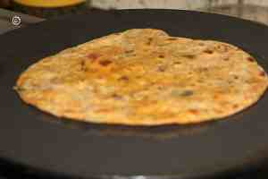 mint paratha being cooked