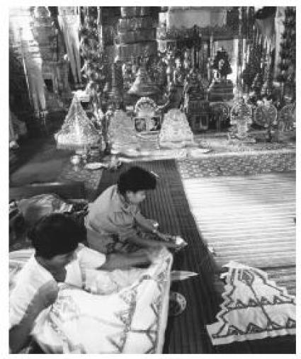 These two Buddha factory workers are representative of the female-dominated industrial work force in Cambodia.