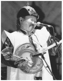 "Ondar, is a Mongolian ""throat singer."" The khoomi singing of Mongolia, in which carefully trained male voices produce a whole harmonic from deep in the throat, gives the impression of several notes coming at once from one mouth."