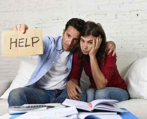 Young couple worried need help in stress at home debt bills bank papers expenses and payments feeling desperate in bad financial situation