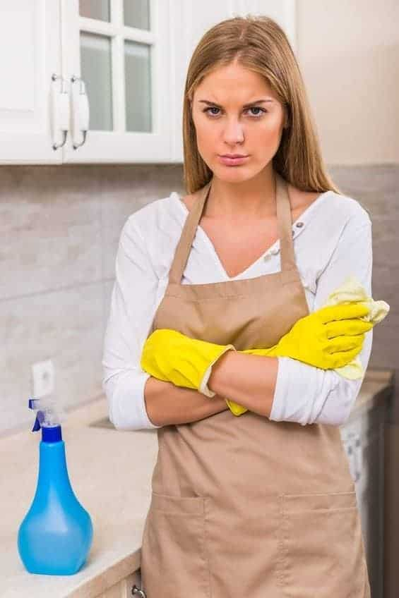 Angry young woman because spray bottle won't spray