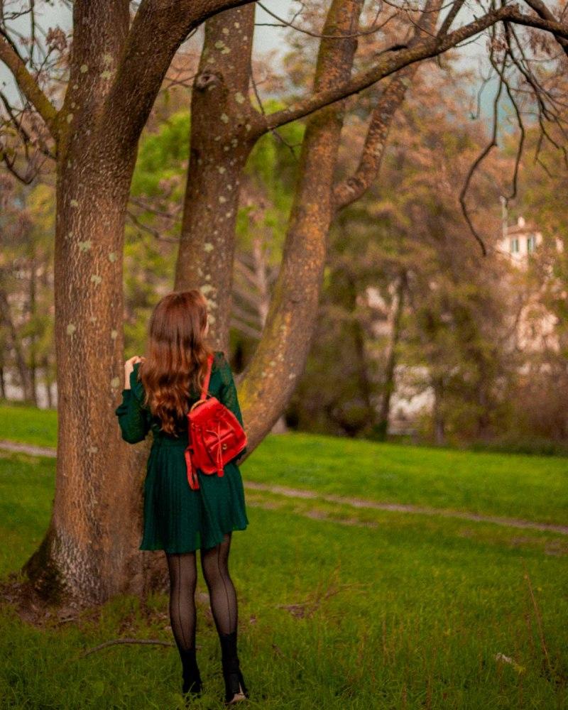 tuta verde e zainetto rosso gucci vintage
