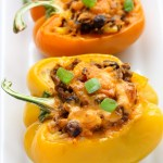 This Mexican Stuffed Peppers recipe is so zesty and full of flavor. A comforting all-in-one meal that is hearty, healthy and gluten-free!   EverydayEasyEats.com