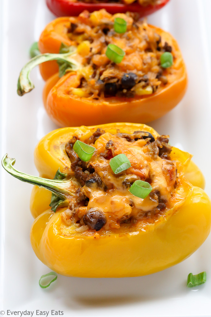This Mexican Stuffed Peppers recipe is so zesty and full of flavor. A comforting all-in-one meal that is hearty, healthy and gluten-free! | EverydayEasyEats.com