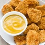 Baked Chicken Nuggets with Honey Mustard Sauce   EverydayEasyEats.com