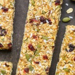 Close-up overhead view of Healthy No-Bake Nut-Free Granola Bars on a dark background.
