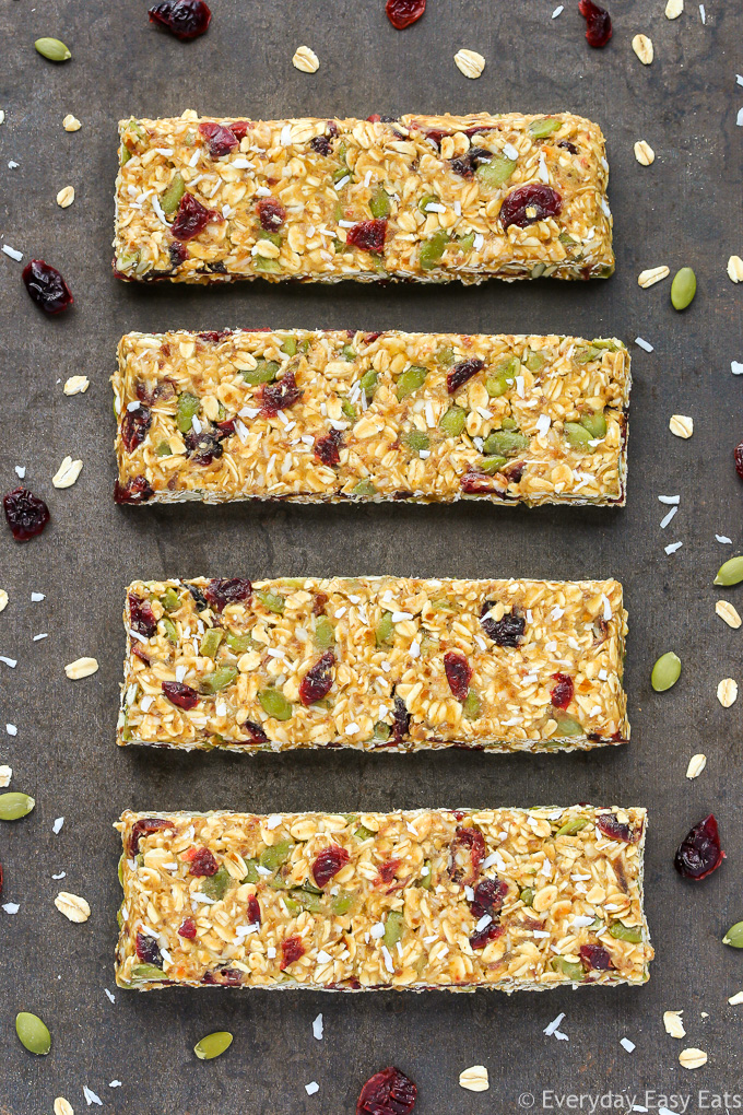 Overhead view of four Healthy No-Bake Nut-Free Granola Bars on a dark background.
