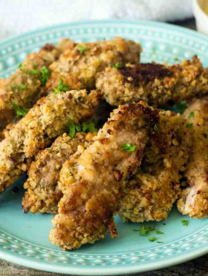 Baked Pecan Crusted Chicken Tenders with Creole Sauce