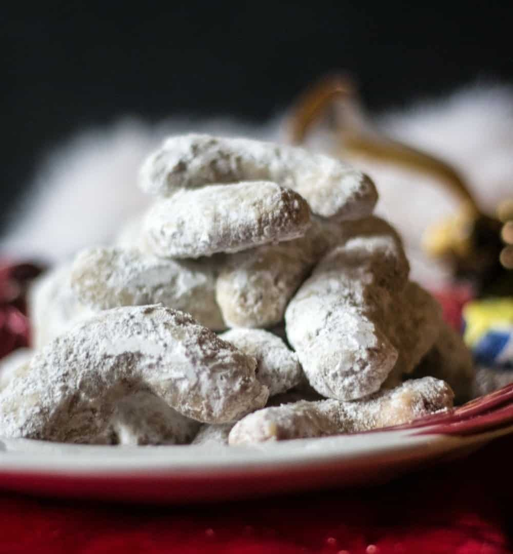 the best pecan crescent cookies on a santa cookie tray