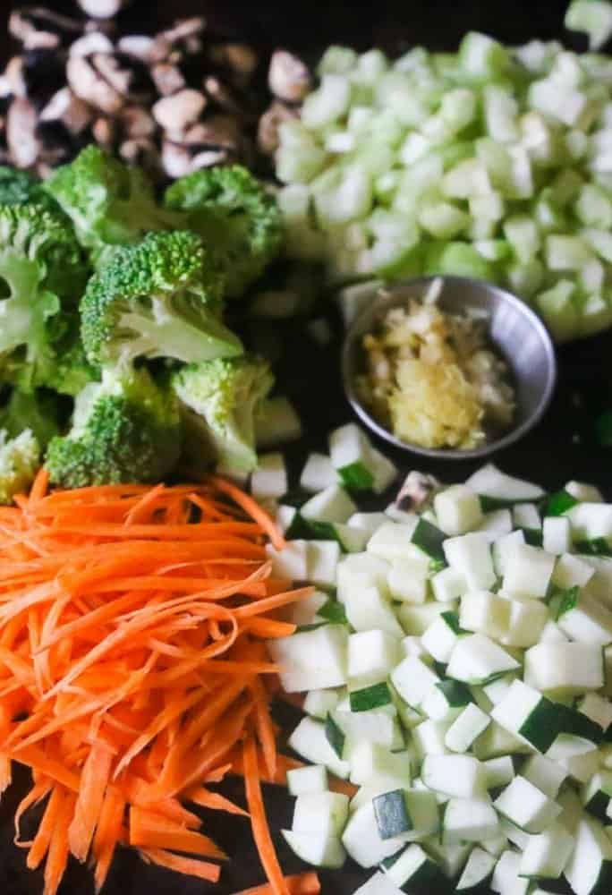 The prep veggies needed to make coconut curry rice. Carrot, broccoli, zucchini, mushroom and ginger