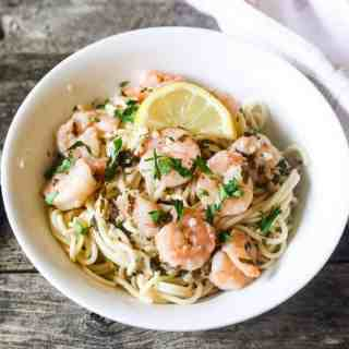 shrimp scampi and pasta lightened up with low-sodium chicken stock, wine and lemon