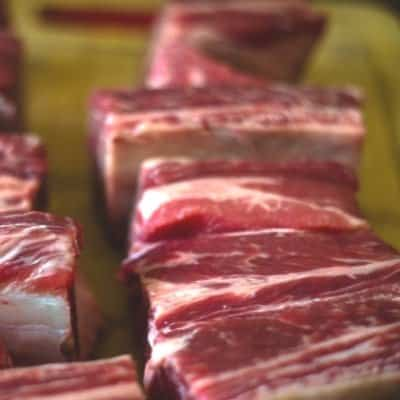 Raw Beef short Ribs seasoned and ready to be seared in an Instant Pot to make Beer Braised Beef Short Ribs