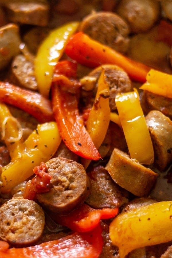 Sausage, red pepper, yellow pepper, and diced tomatoes to make Sausage and Peppers