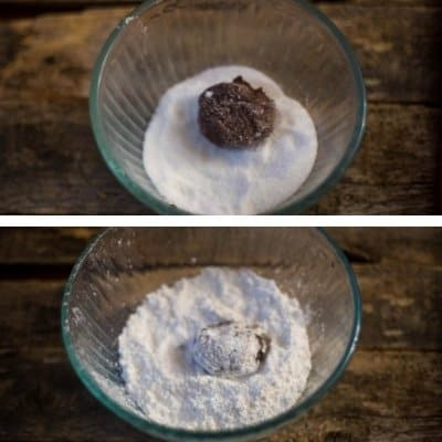 Chocolate crinkle cookie dough rolled in white sugar and then confectioners sugar before baking.