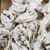 Instant Pot shredded chicken that has been poached and shredded ready to be used in quesadillas, tacos, soups, salads, etc.