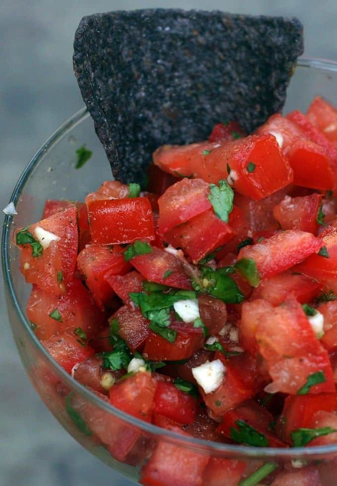 Authentic pico de gallo recipe with blue corn tortilla in the salsa