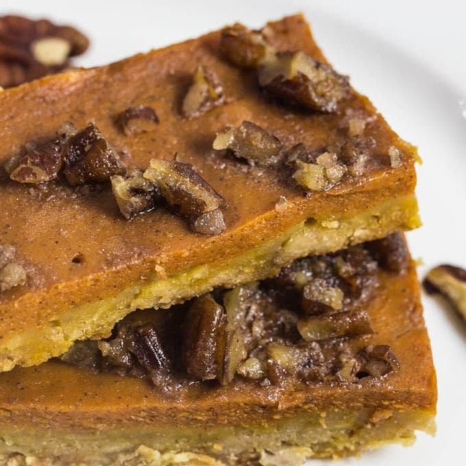 Delicious pumpkin pie bars topped with pecans.