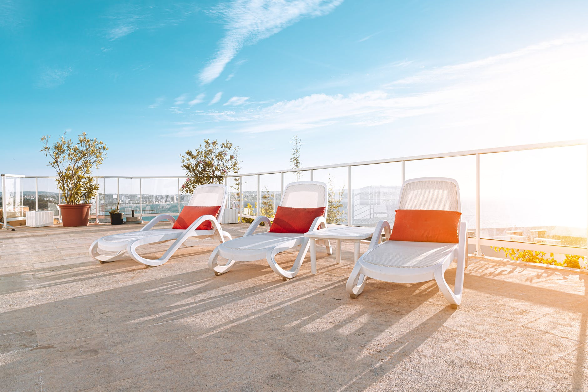 photo of three white deck chairs sun loungers