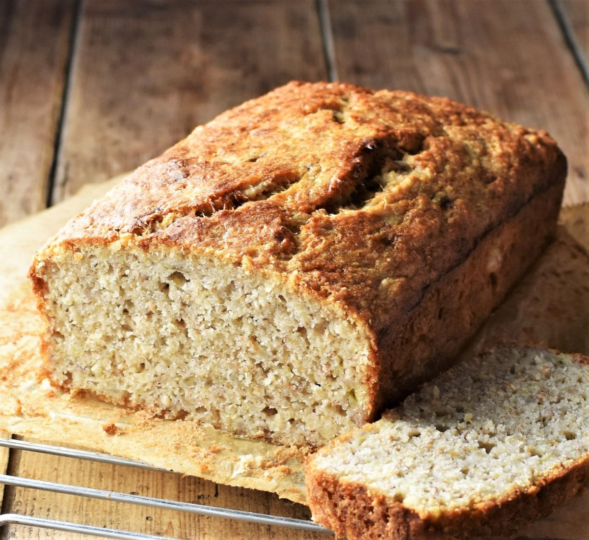Side view of banana bread on top of rack.