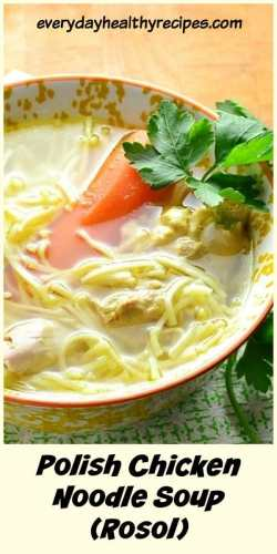 Close-up view of chicken noodle rosol soup in white-and-yellow bowl.
