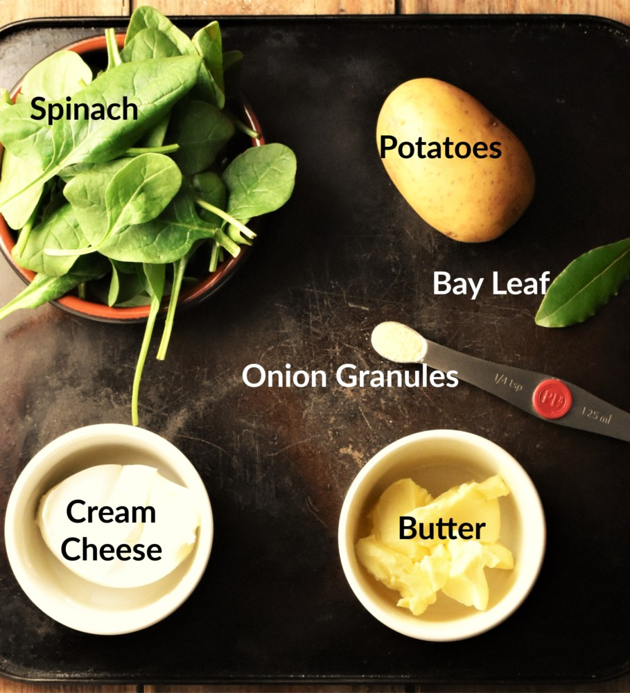 Spinach mashed potato ingredients in separate dishes.