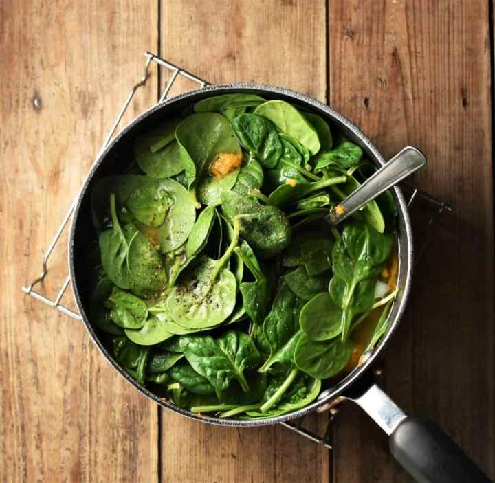 Spinach in pot with spoon.