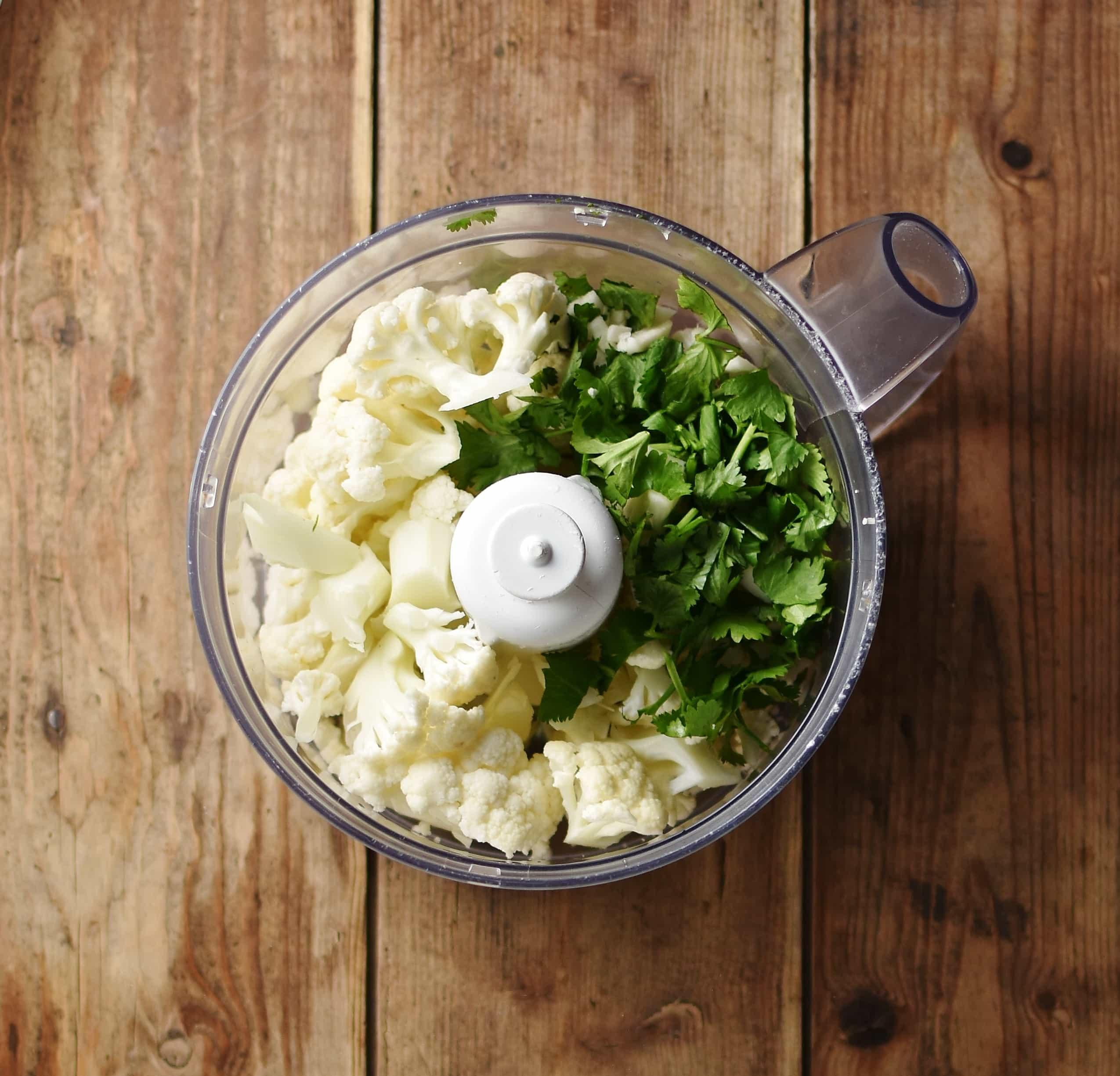Chopped cauliflower and cilantro in blender.