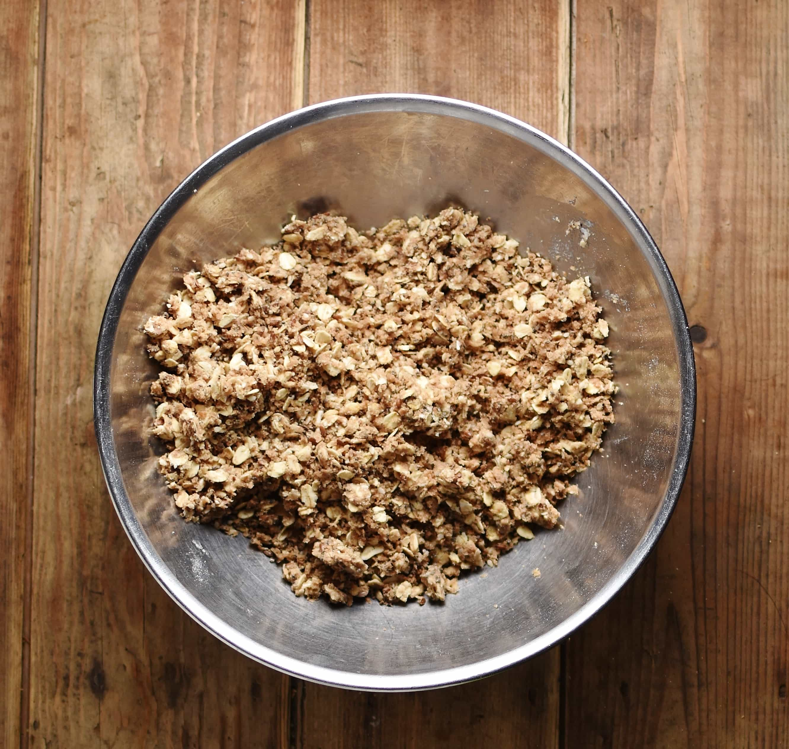 Crumble topping inside metal bowl.
