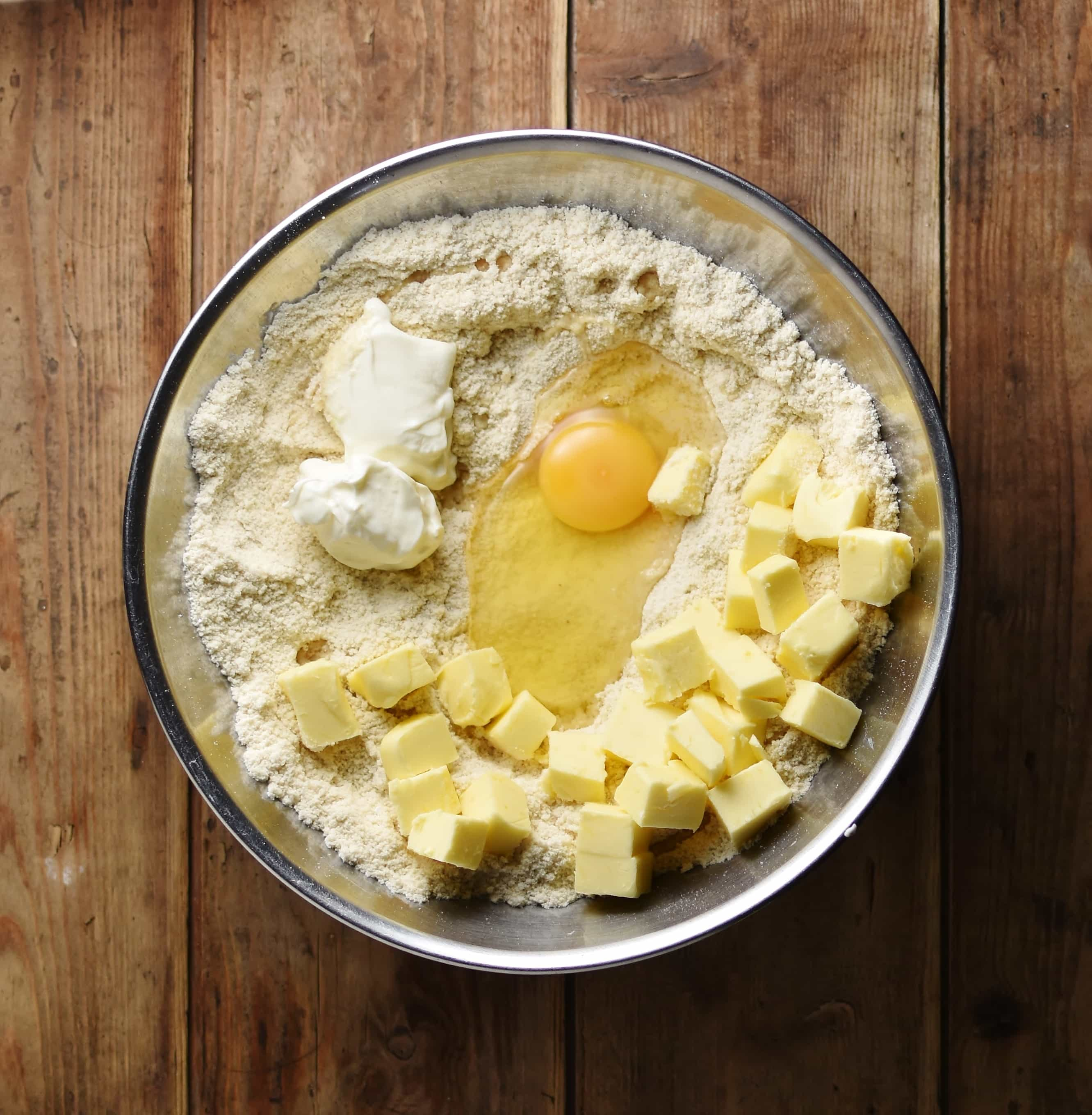 Flour, egg and cubed butter in metal bowl.