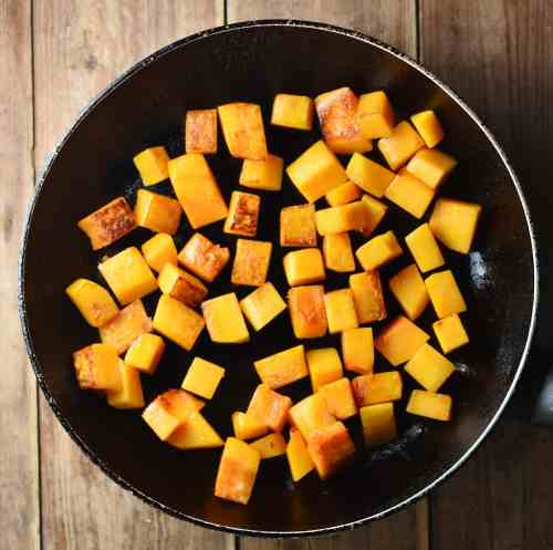 Cubed fried squash in large pan.