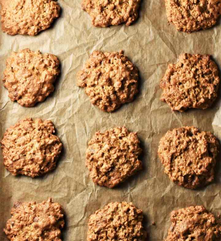 Peanut butter cookies on top of parchment.