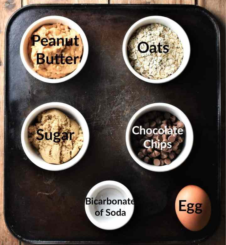 Peanut butter oat cookies ingredients in individual dishes.